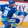 NHL-Canucks-Virtanen-celebrates-goal-against-Flames