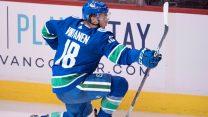 NHL-Canucks-Virtanen-celebrates-goal-against-Flames