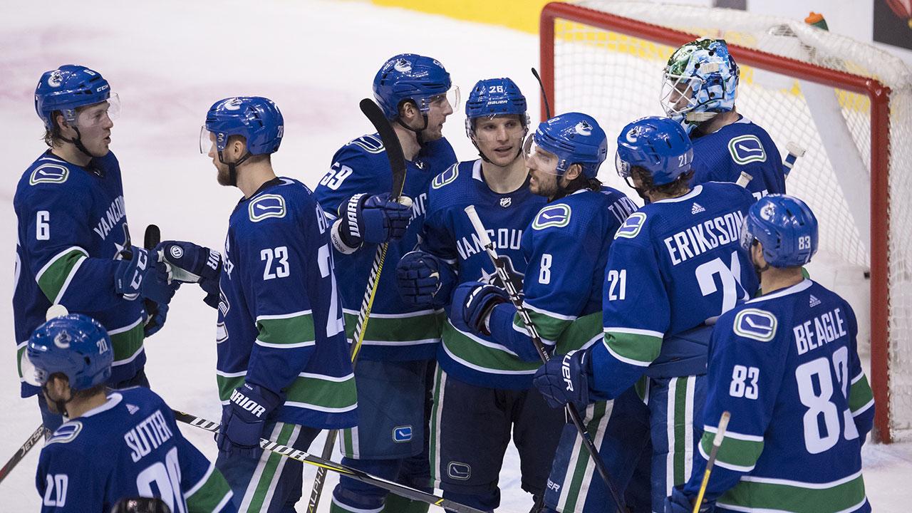 NHL-Canucks-celebrate-win