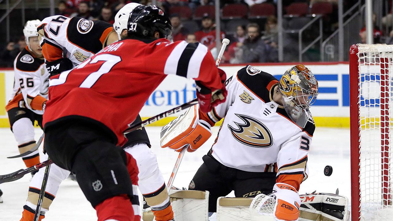NHL-Ducks-Gibson-makes-save-against-Devils
