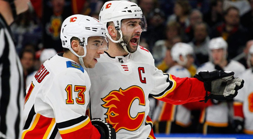NHL-Flames-Gaudreau-celebrates-goal-with-Giordano