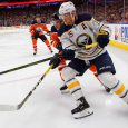 NHL-Sabres-Eichel-battles-for-puck-against-Oilers