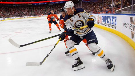 NHL-Sabres-Eichel-battles-for-puck-against-Oilers