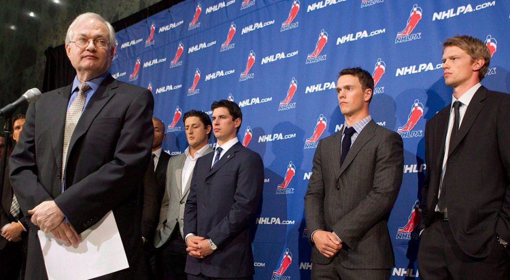NHLPA-executive-director-Donald-Fehr-stands-with-players-following-collective-bargaining-talks