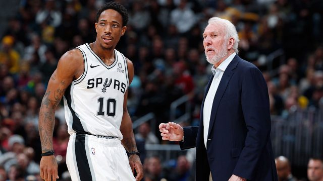 gregg-popovich-confers-with-demar-derozan