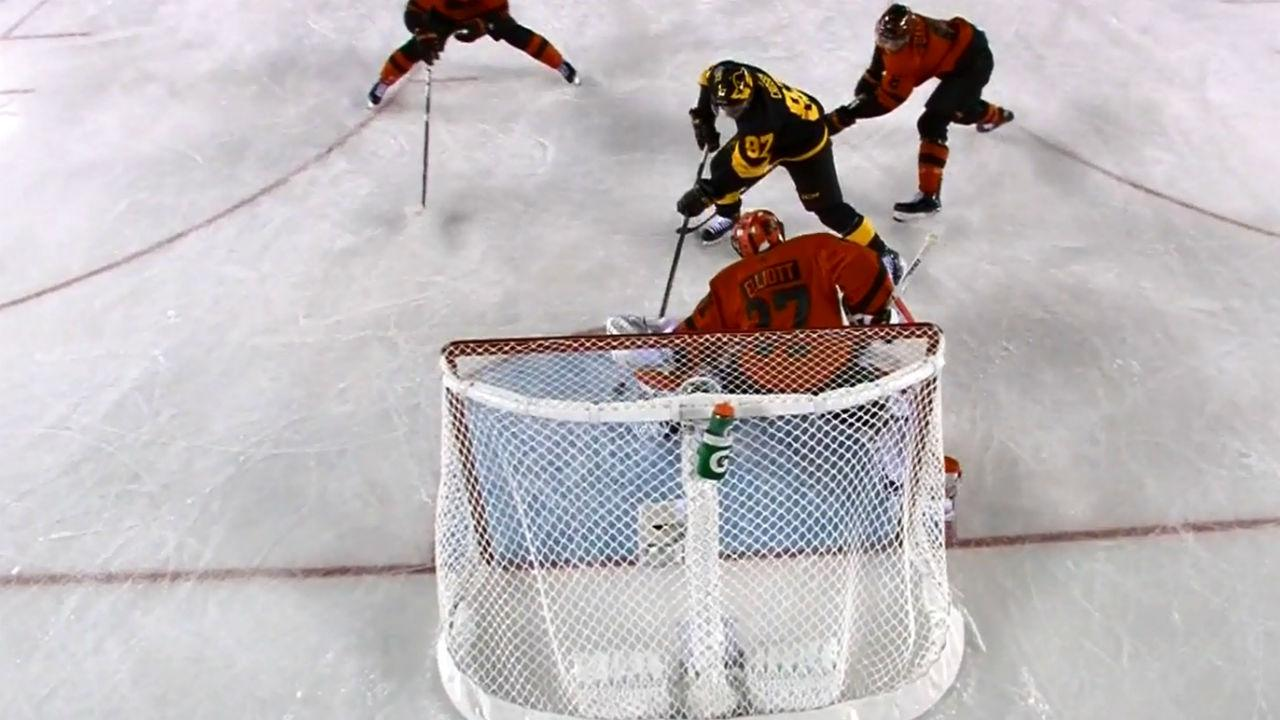 reputable site e0199 3cae0 Sidney Crosby dekes past Elliott for Stadium Series' opener ...