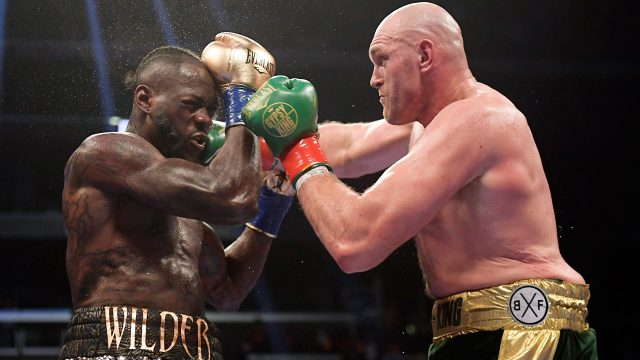 Deontay-Wilder-Tyson-Fury-trade-punches