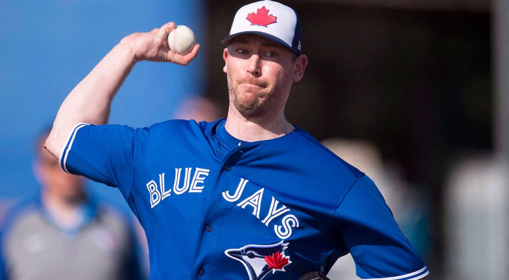 MLB-Blue-Jays-Axford-throws-during-spring-training