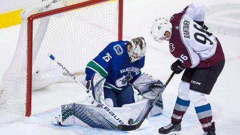 NHL-Canucks-Markstrom-stops-Rantanen-shot