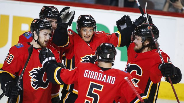 NHL-Flames-celebrate-goal-against-Coyotes