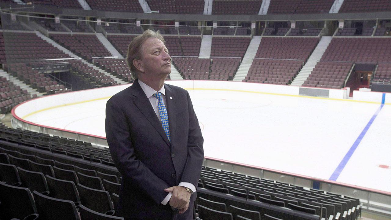 NHL-Senators-Melnyk-stands-inside-arena