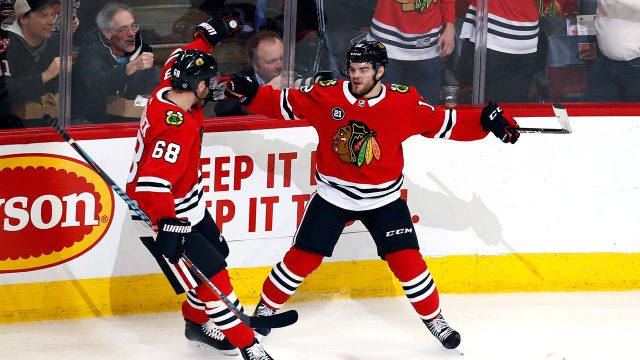 alex-debrincat-celebrates-with-slater-koekko