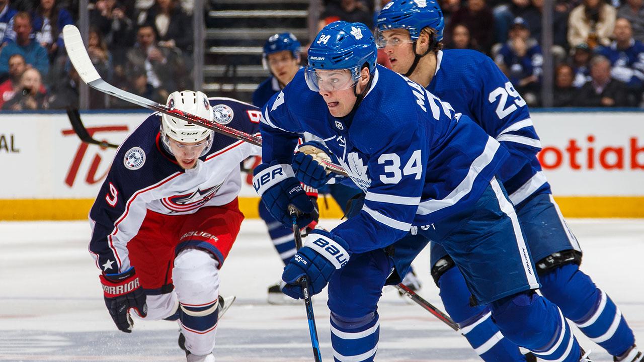 Auston-Matthews-and-Artemi-Panarin-compete-in-NHL-action