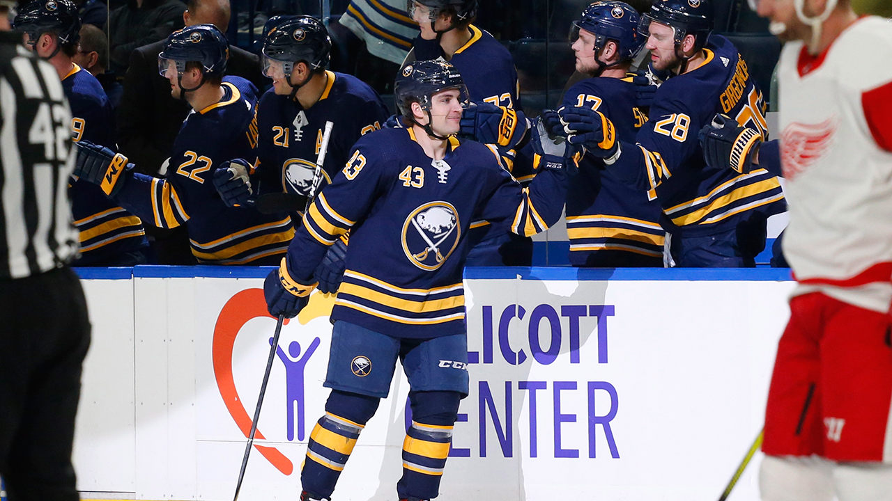 conor-sheary-celebrates-goal-with-sabres-teammates