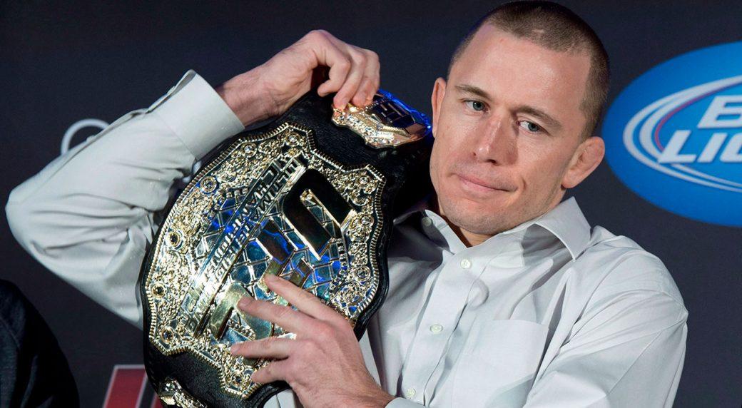 georges-st-pierre-holds-ufc-welterweight-title-belt