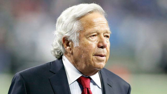 robert-kraft-walks-on-a-field