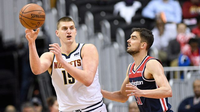 NBA-Nuggets-Jokic-passes-against-Wizards