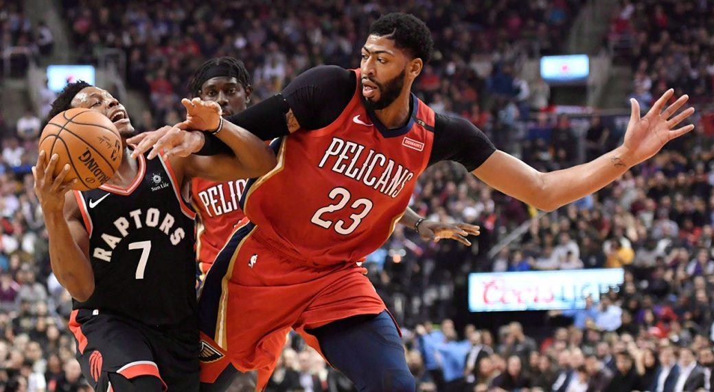NBA-Raptors-Lowry-drives-against-Pelicans-Davis