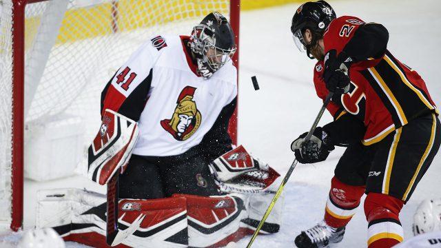 NHL-Flames-Lindholm-makes-save-against-Senators