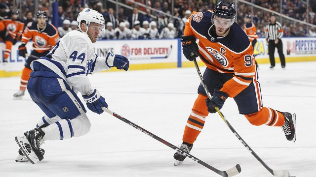 NHL-hockey-Oilers-McDavid-shoots-against-Maple-Leafs