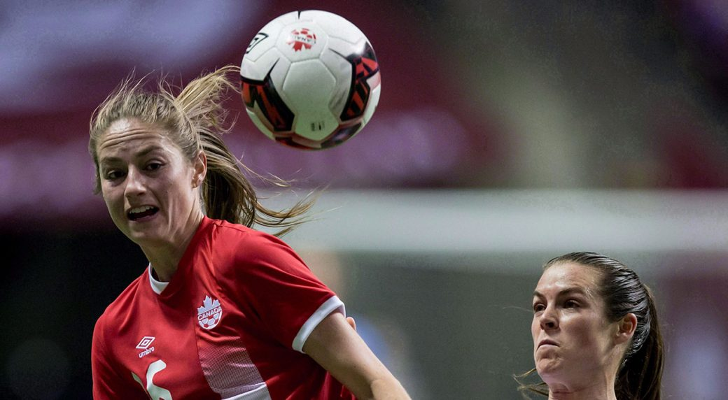 Soccer-Beckie-heads-ball