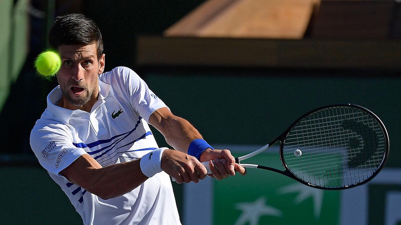 Tennis-Djokovic-returns-shot