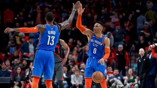 russell-westbrook-and-paul-george-high-five-each-ther