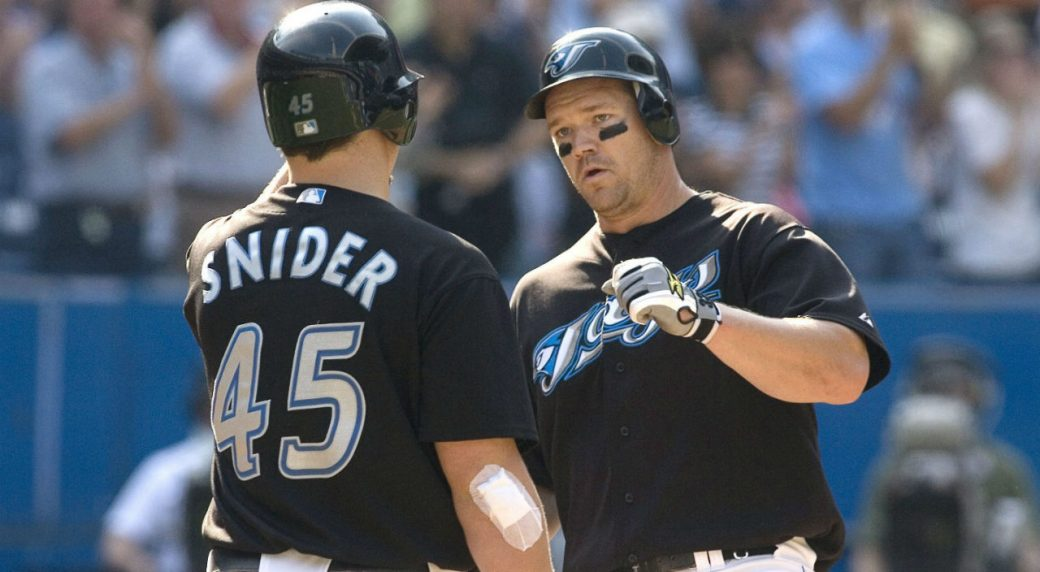 Scott-Rolen-(right)-is-congratulated-by-Travis-Snider,-after-hits-a-solo-home-run,-during-eigth-inning-AL-action-in-Toronto-on-Saturday-September-20th-2008.-THE-CANADIAN-PRESS/Chris-Young