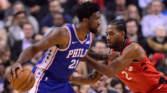 76ers-joel-embiid-controls-ball-against-raptors-kawhi-leonard