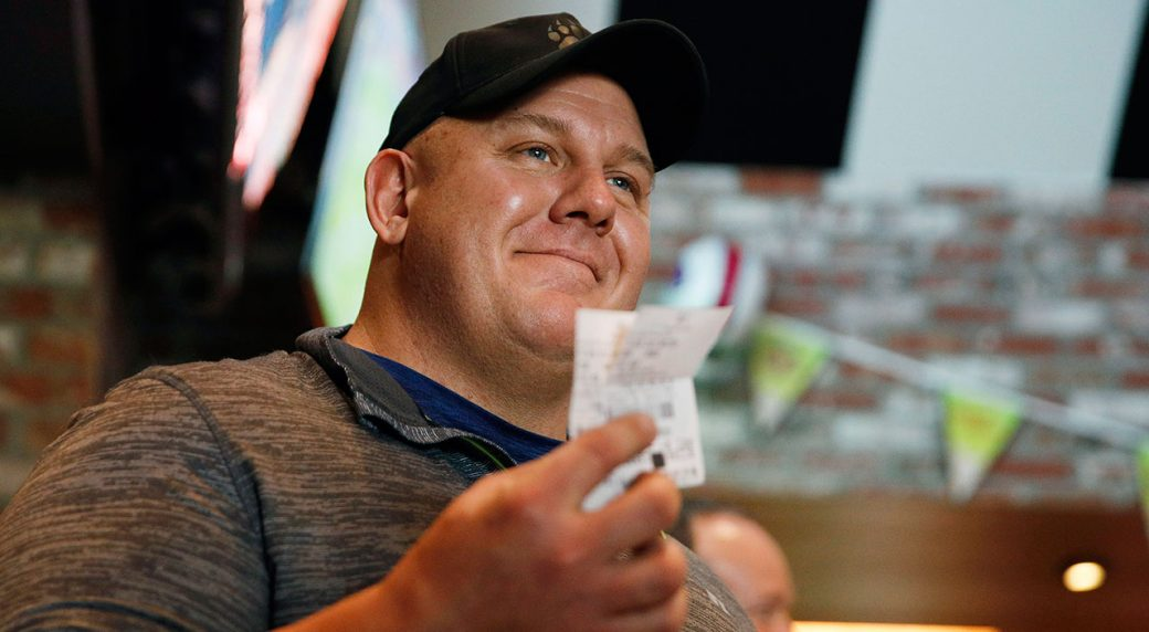 Golf-fan-holds-up-ticket-after-Tiger-wins-Masters