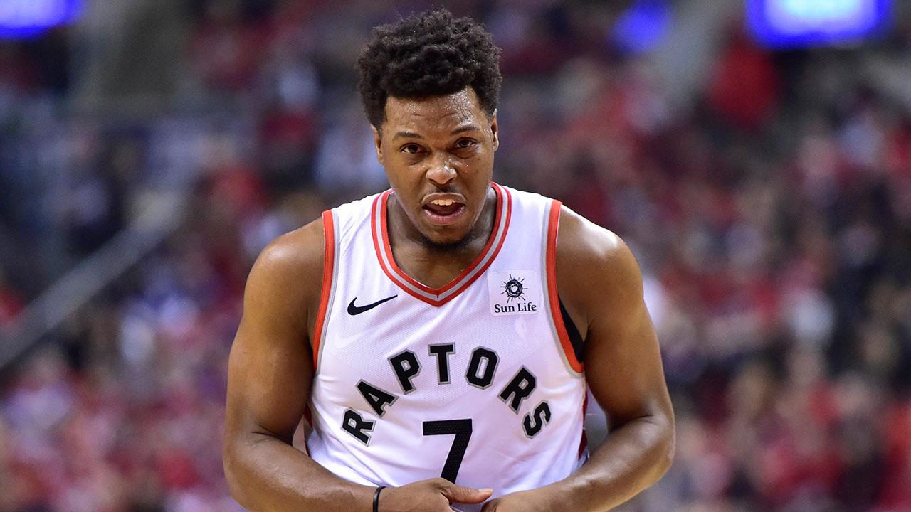 NBA-Raptors-Lowry-winces-in-pain