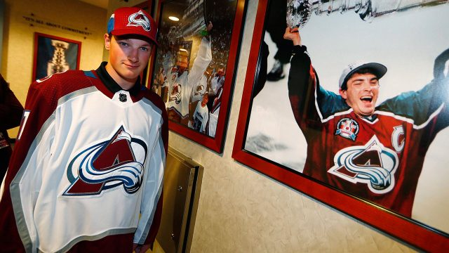 NHL-Avalanche-Makar-poses-next-to-photo