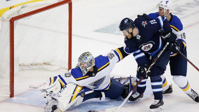 NHL-Blues-Binnington-makes-save-against-Jets
