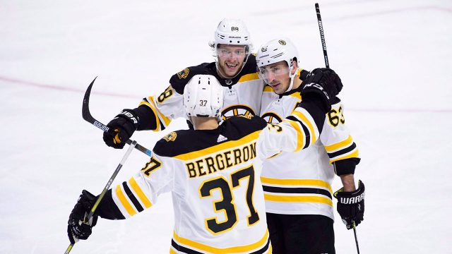 NHL-Bruins-top-line-celebrates-goal