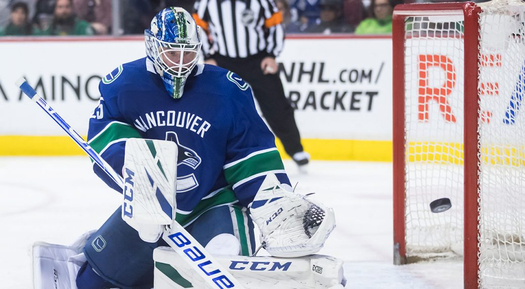 NHL-Canucks-Markstrom-makes-save-against-Stars