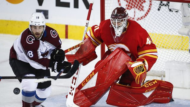 NHL-Flames-Smith-makes-stop-against-Avalanche