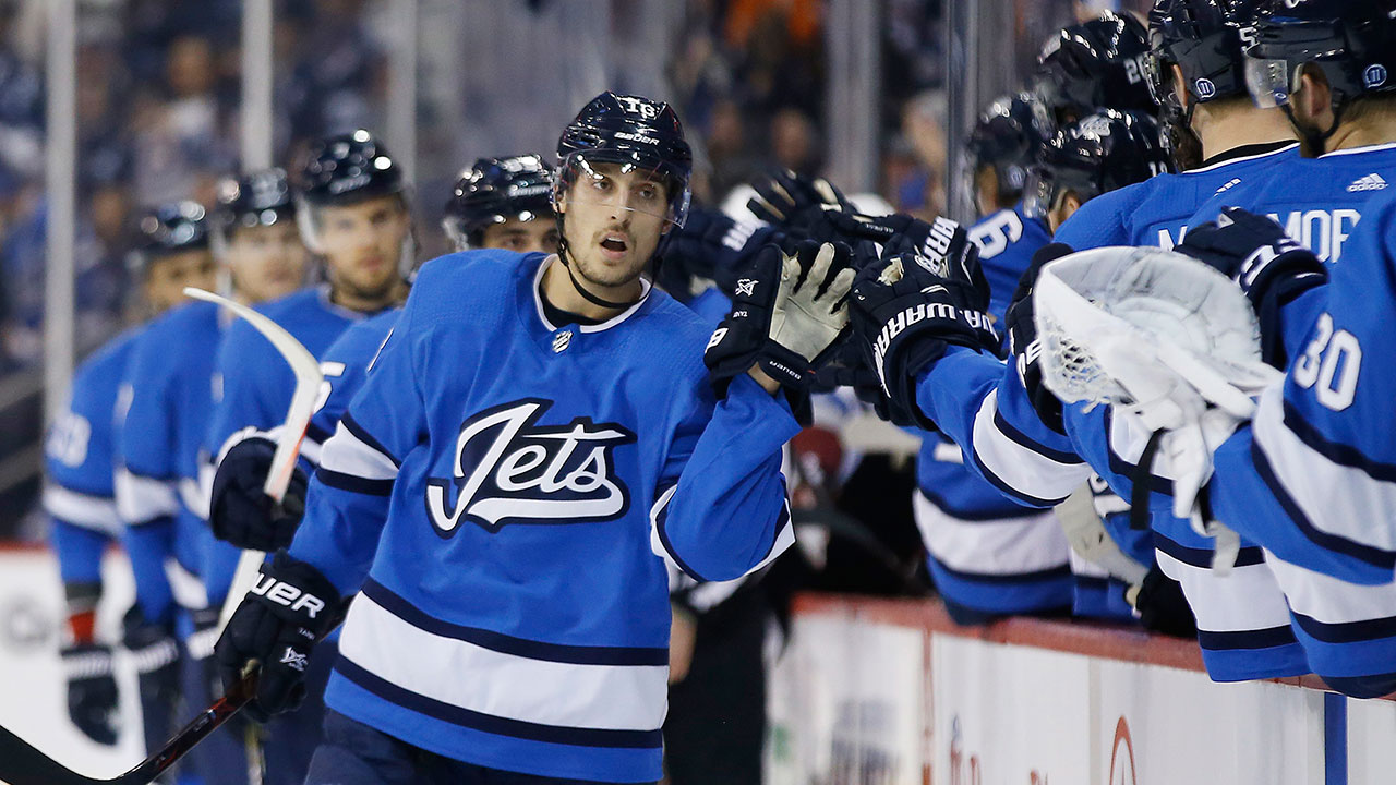 NHL-Jets-Tanev-celebrates-goal