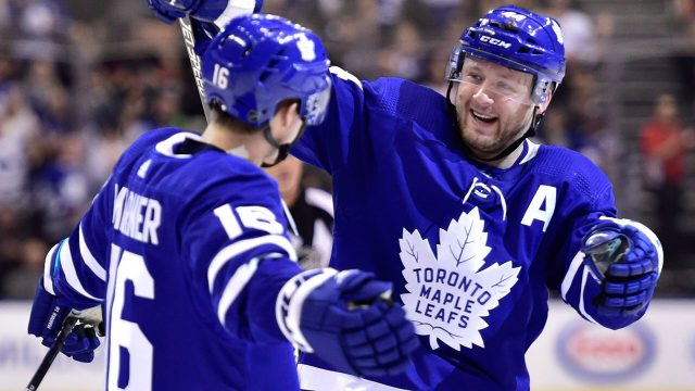 NHL-Maple-Leafs-Rielly-celebrates-goal-with-Marner