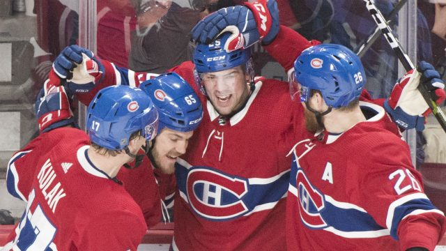 Montreal-Canadiens'-Ryan-Poehling-(25)-celebrates-with-teammates-Brett-Kulak-(17),-Andrew-Shaw-(65)-and-Jeff-Petry-(26)-after-scoring-against-the-Toronto-Maple-Leafs-during-third-period-NHL-hockey-action-in-Montreal,-Saturday,-April-6,-2019.