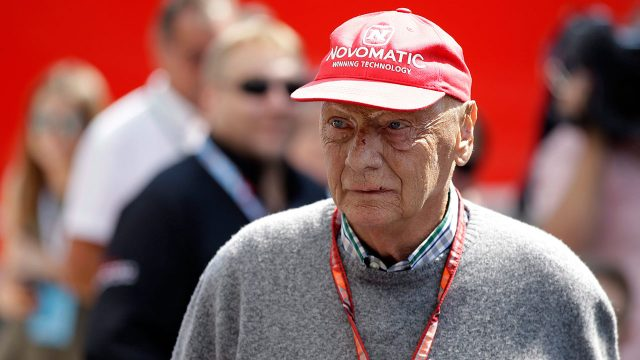 Auto-racing-Niki-lauda-stands-on-racetrack