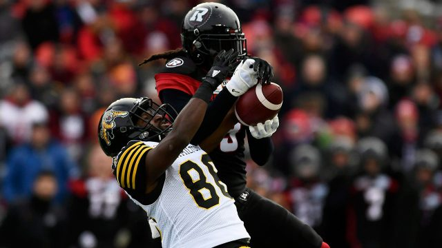CFL-football-Murray-goes-for-catch-against-Tiger-Cats
