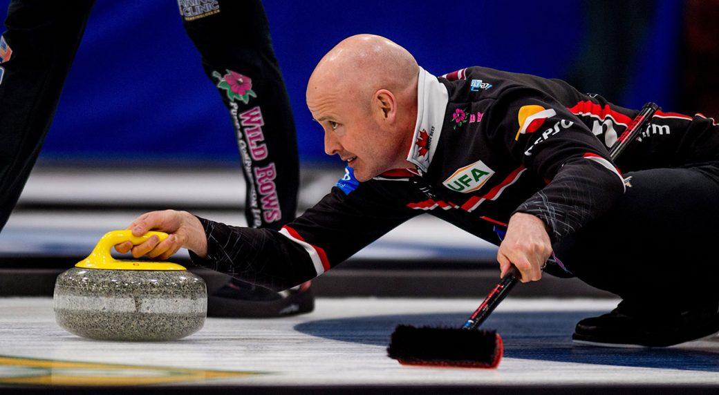 Curling-Koe-throws-rock