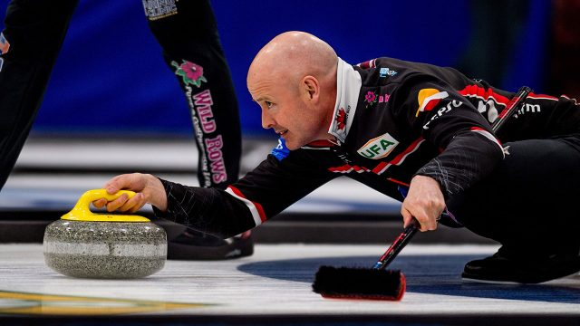Curling-Koe-throws-rock