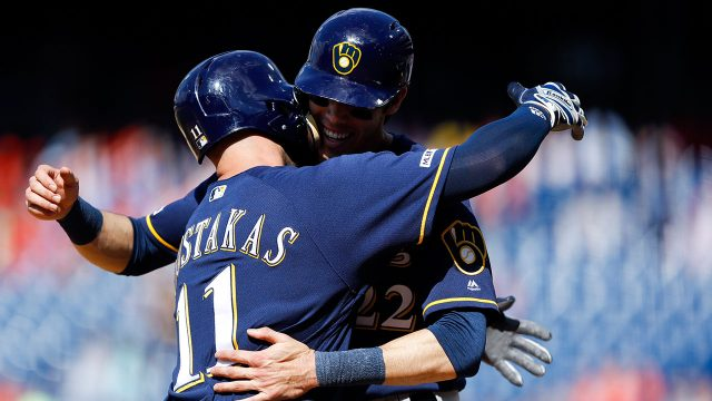 MLB-Brewers-Yelich-celebrates-with-Moustakas-after-home-run