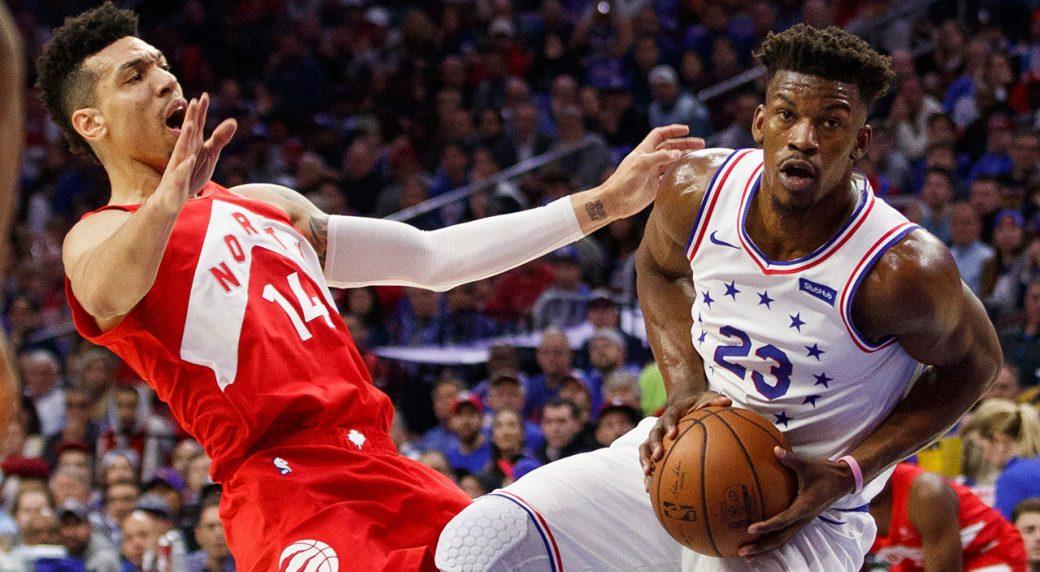 NBA-76ers-Butler-drives-against-Raptors-Green