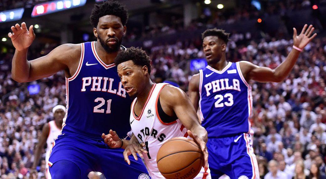NBA-Raptors-Lowry-drives-against-76ers