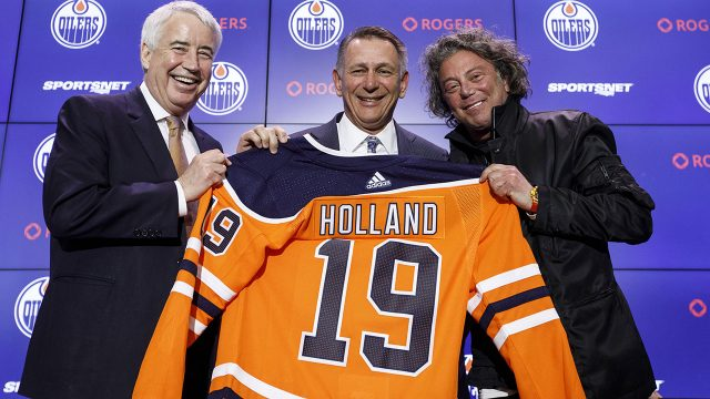 NHL-Oilers-Holland-poses-at-press-conference