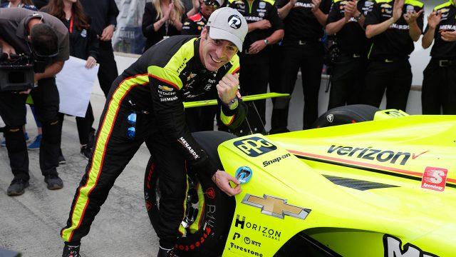 Simon-Pagneaud-places-pole-award-on-car