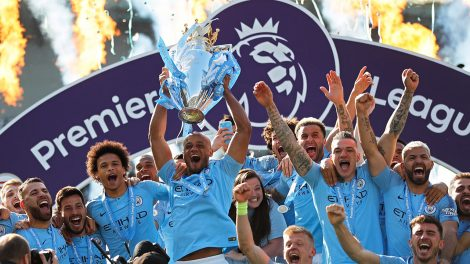 Soccer-Man-City-lifts-Premier-League-trophy