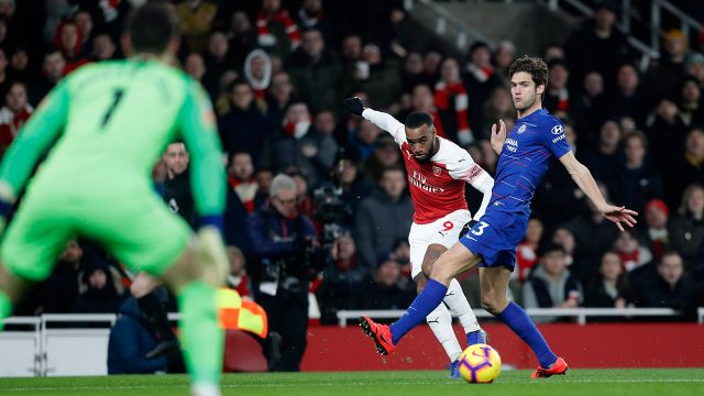 arsenals-alexandre-lacazette-shoots-as-chelseas-marcos-alonso-defends